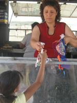 Nina serving kids at the Kids Feeding Program